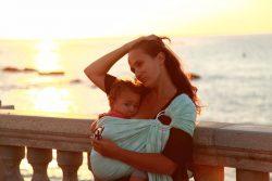 Koala and Mama Malta Babywearing Consultancy Breastfeeding in a Pinknova ring sling by the sea
