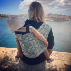Koala and Mama Babywearing Malta looking at the grand harbor in Valletta in artipoppe argus neneh woven wrap